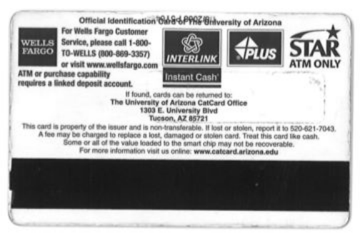 back of biometric card with black stripe at the bottom