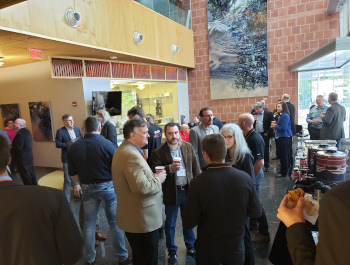 People networking in Keating lobby during AZ Photonics Days