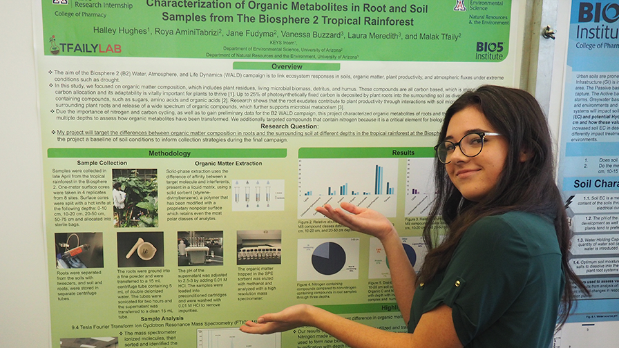 High school student presenting a scientific poster