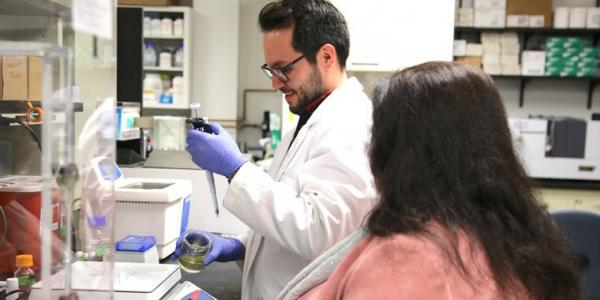 Dr. David Encinas, Postdoctoral Research Associate and Dr. Heidi Mansour, collaborating in the lab. Photo: Paul Tumarkin/Tech Launch Arizona
